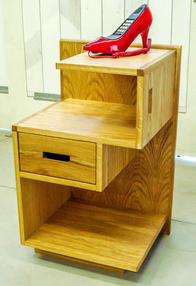 white oak nightstand with off center drawers and shelves