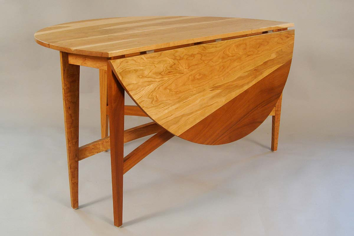 collapsible table with dark and light woods